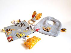 sSCAPESs art & handmade This gift set consisting of bandana bib, taggie blanket and bunny ear teether is perfect for your favorite little one's fashionable needs and playtime. Each piece is One Of A Kind (OOAK) - unique and original sSCAPESs design made in Vienna, Austria/European Union.  All sSCAPESs handmade items are made of high quality eco-certified baby-friendly cotton with great love for detail.