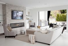 Family Room Fireplace - Design photos, ideas and inspiration. Amazing gallery of interior design and decorating ideas of Family Room Fireplace in living rooms, dens/libraries/offices, basements by elite interior designers. Tv Above Fireplace, Linear Fireplace, Living Room With Fireplace, Fireplace Design, Fireplace Stone, Fireplace Ideas, Fireplace Modern, Living Room Tv, Living Room Modern