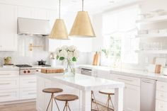 Chic White Kitchen with gold hardware...wish they said where the faucet and hardware were from :(