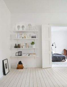 Light colors, white wood floors, and pretty shelving