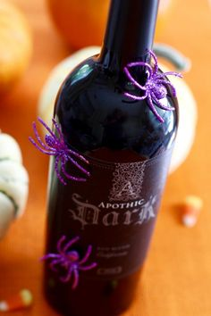From Halloween wreaths to pumpkin decor, check out this list of easy Halloween decorations to get into the spooky spirit today! Halloween Table Decorations, Halloween Wreaths, Pumpkin Decorating, Simple Way, Spider, Alcoholic Drinks, Bottles, Lily, Glitter