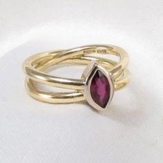 Gold Ruby Iona Ring, handmade by Seth Gardner... so beautiful http://www.artofgoldgalleries.co.uk/jewellery/Seth_Gardner.asp