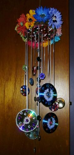 There is stained glass (melted beads) underneath and the top is open. The idea for that is so the sun will shine through the stained glass making the chimes sparkle more.