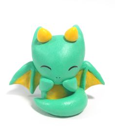 Adorable green dragon figurine made out of polymer clay! This is a perfect gift for any dragon or fantasy lovers.