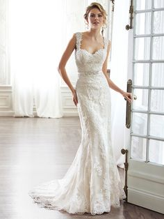 Maggie Sottero - PIA, DISCONTINUED - The pinnacle of romance is found in this streamlined sheath. Rendered in lace  and completed with a dramatic V-back. Beautifully detailed with illusion lace. Finished with sweetheart neckline and delicate cap sleeves. Finished with covered button over zipper and inner elastic closure.