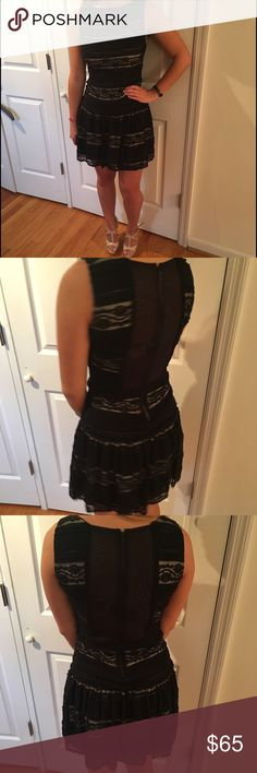 Alice and Olivia Dress Flirty and flouncy black with tan underlay dress. See pictures, back has see thru mesh. 31 inches from top to bottom of hem. Only worn two times. Great dress for summer weddings, Derby parties, brunch, dates, very versatile. Alice + Olivia Dresses Mini