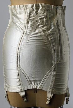 Nylon, rayon, and rubber girdle, ca. 1950. The girdle serves to smooth and contain the waist/hip area, while often serving as a functional garment with attached garter belts. (The Metropolitan Museum of Art)