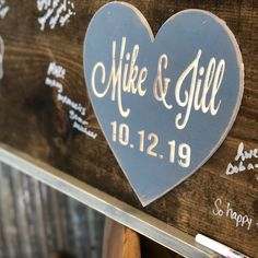 Engraved heart on a rustic guestbook for guests to leave their special messages