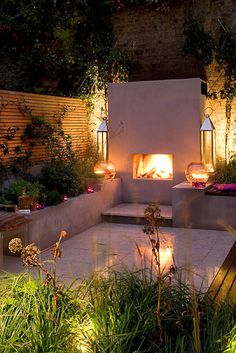 Gardening Autumn - Great little outdoor space with a fireplace and lighting so it can used at night and on warm spring or autumn evenings - With the arrival of rains and falling temperatures autumn is a perfect opportunity to make new plantations Outdoor Areas, Outdoor Rooms, Outdoor Decor, Interior Exterior, Exterior Design, Garden Spaces, Dream Garden, Outdoor Lighting, Lighting Ideas