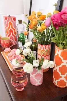 a fun way to spruce up your vases and make them look pretty- scrap book paper / contact paper over vases.  #DIY #Craft #Entertaining