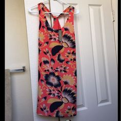 NWT foral dress Beautiful brand new with tags coral colored dress with floral design. Really pretty straps in the back. Tags says 00 but it runs like a 0 so unfortunately it's too big on me :( Might even fit a 2. So gorgeous! J. Crew Dresses