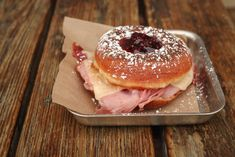 Bakery: Donuts and Sliders Location: New Orleans, Louisiana This grilled donut sandwich is filled with smoked ham, Havarti, and Dijon, and topped with preserves and powdered sugar for a doughy blend of salty and sweet. For more information, visit donutsandsliders.com.   - Delish.com