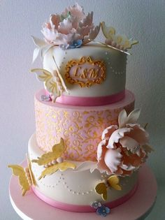 Wedding anniversary cake in pink and gold
