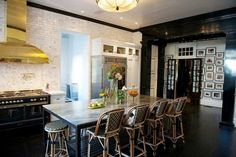 I love the current #fad of #gold, #white & #black for interior design. I really like this #kitchen. The #gold vent-hood & the #marble backsplash configurations the best.