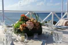 #wedding #centrepiece made of peach roses, hydrangeas, tulips, orange cymbidium, lily grass. Celebrations Ltd | Cayman Weddings & Events
