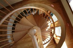 Arc-ways spiral staircase by B&E General Contractors in Glendale, WI. Remodel also features a balcony with matching railing.