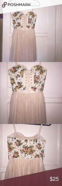 Cute corset sun dress Gorgeous cream sun dress . With a corset inspired top . Topped off with floral pattern and tulle bottom . Never worn sidecoa Dresses Midi