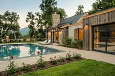 Consider a small section of the exterior to be metal like the picture above. I like the color scheme with wood, metal, stone and tin roof. Mountain Home Exterior, Mountain House Plans, Dream House Exterior, Style At Home, Hill Country Homes, Ranch Remodel, Modern Farmhouse Exterior, Dream Home Design, Cottage