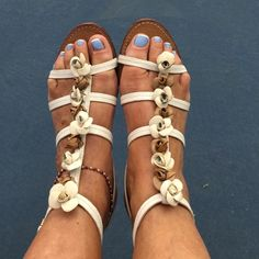 Tory Burch ivory multi flower straps sandals Tory Burch ivory brown multi flower straps sandals with side closure, very little worn , gorgeous trendy sexy must have accessories Tory Burch Shoes Sandals