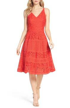Swooning over this red fit-and-flare dress made modern with a sheer, scalloped hem.