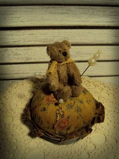 Teddy on pin cushion