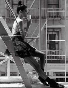 Taking a coffee break, Valentino wears a tank top over Valentino dress with studs and tulle. Look 53