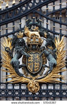 Royal Crest at Buckingham Palace Gate in London, United Kingdom