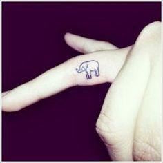 Elephant tattoo on inside of finger