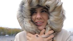 Closeup Of Woman In A Jacket With The Hood She Closed From The Strong Cold Wind - Stock Footage | by travelexdi