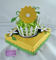 Crafter's Companion; Kendra Wietstock; Die-sire Picket Fence Cupcake Wrapper; 3D Flowers Forget Me Not; Flower Topper. Box made using The Ultimate Crafter's Companion Tool.