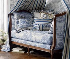 This looks ideal - perfect space for curling up with a hot chocolate to read a good book :-) Love the blue toile fabric!