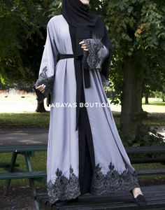 Currently Out of Stock, will be Restocked soon! Grey Abaya with Black and Silver Lace stunning abaya with striking contrast. With a bold colour combination Grey and Black Lace. It's a trend setter in a classic flawless shape and with all important front opening. Can be worn with robe tassel belt. Which can be purchased from website.