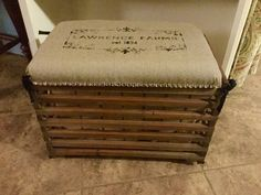 Old fruit crate ottoman I upholstered with some material I embellished with my Silhouette Cameo. Mom sewed the liner and Dad attached the top and added some wheels.