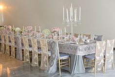 Beautiful subtle table design. These are Chiavari chairs witih the backs covered - I believe Elite Productions has them available (maybe not with the covers though).  Photo by Jessica Claire