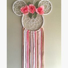 Salmon Rose Minnie Mouse Dreamcatcher  Made with: Wood, florals, yarn, trims, and ribbons  Large size Dreamcatcher  Handmade in NJ  Perfect for: Nursery decor, home decor, kids room decor, photo props, birthdays, parties, or gifts!