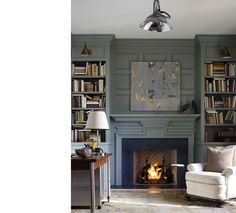 This room is a favorite of mine. My favorite elements are the herringbone pattern of the brick inside the fireplace and the slate around the surround, as well as the gray/blue paint. The calming color and uncluttered room is a nice contrast to the helter skelter effect of the books in the shelves.
