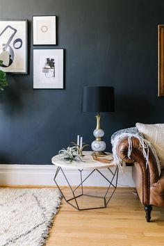 Modern Industrial Home Interior Design Inspiration featuring round coffee table used as end table next to brown leather couch with white throw, navy wall, boho rug Pinterest Home, Room Decor, Room Inspiration, Home Trends, Interior Design, House Interior, Home Living Room, Interior, Home Decor