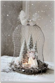 Serene white Christmas scene - made with chicken wire cloche, bristol Christmas trees spray painted white and angels made with vintage print paper and coffee filters