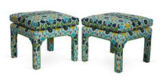 """""""Statement-making pair of blue, yellow, and white ottomans that ooze style. Place these in front of your bed or employ them as occasional seating in your den."""""""