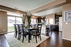 Like the soffit between the kitchen and dining.Hardwood floors and dark cabinets. The Genesee by Oakwood Homes