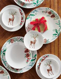 An original painting becomes festive tableware in the handcrafted Woodsy Wonderland Holiday Dinnerware. A ceramic decal beautifully reproduces the artist's strokes on white porcelain. With a classic palette and simple design, this collection is an effortless layer for holiday table settings.