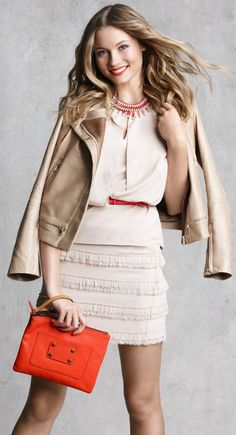 ruffled skirt, motorcycle jacket, and flow-y blouse... a bit of everything perfectly  put together