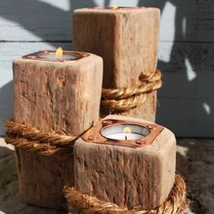 Could use 4X4, use a hammer and other tools to mar them and homemade stain.....Driftwood tea light holders... would look fantastic in our house...