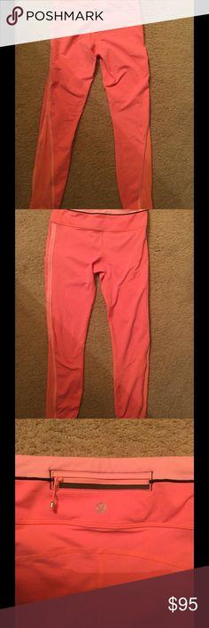 Lululemon mesh orange full length leggings . Rare Rare Lululemon orange with pink zip back mesh full length leggings . Pristine condition worn handful times .Price firm lululemon athletica Pants Leggings