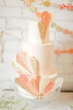 art deco Peach and cream cake featuring sugar lace patterns
