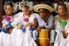 Children wearing Pollera national dress at La Mejorana music festival.  Photo by Alfredo Maiquez for Lonely Planet.