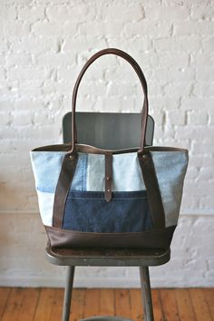 1950s era Double Denim Carryall. Bag measures approximately 19 in wide, 13 in tall, 5 in deep.  Strap drop approximately 12 in.