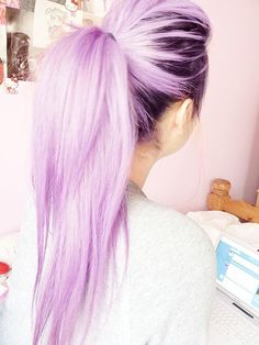 Dark roots and lavender hair.
