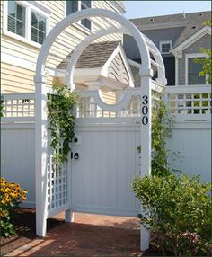 Spindle Top Arbor and Board Gate - A semi-circular top transforms a board gate from being merely private to being completely charming. Lattice side panels on the arbor encourage your favorite climbers, from roses to vines to clematis and more.