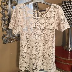 Lovely lace top Very pretty natural color cotton lace with gold buttons in back.  Dulcie Tops